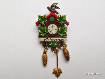Cuckoo clock brooch. Fashion jewelry. Mid-century design.