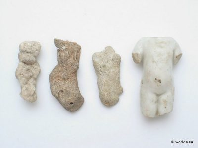 Sculpture and Natural Design. Prehistoric idols. Torso of a porcelain doll. Three sculpture artifacts from the baltic sea