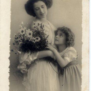 Mother and child. Art Nouveau era costume. German Empire