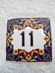 Glaced Greece Tile. Flowers and numbers motiv. Ornamental Wall and floor tiles. Greek souvenir