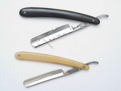 Antique straight razor. Old-fashioned razor. Collectible cut-throat razors.