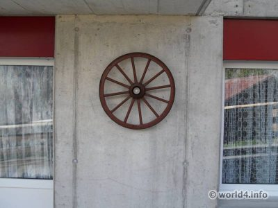 Balcony design with wooden wheel. New Switzerland design